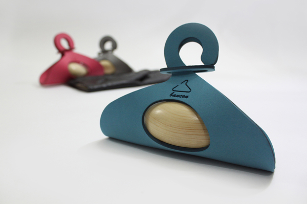 Bancon Hanger, a Soft Padded Foam with a Wooden, River Stone-Shaped Insert by Ali Haji & Amin Saadat