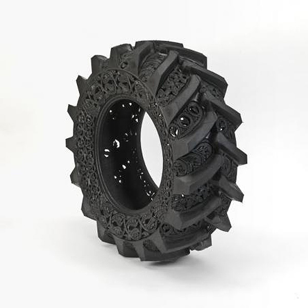 Old Tires Carved with Intricate Scrollwork by Wim Delvoye