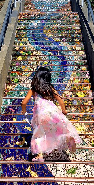 Girl runs up San Francisco's 16th Avenue Tiled Steps by Abe Kle­in­feld